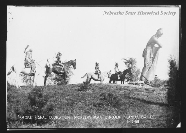 """The \""""Smoke Signal\"""" sculpture dedication in Pioneer's Park, Lincoln, NE. Four Native American men on horseback at the \""""Smoke Signal\"""" sculpture dedication in Pioneer's Park. 09/12/1935"""